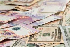 US dollar and Argentine peso bills Stock Photo