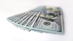 US-Dollar auf weißem Hintergrund Stockfotografie