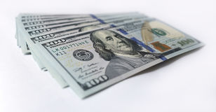 US-Dollar auf weißem Hintergrund Stockbilder