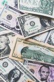US-Dollar Banknotenhintergrund Stockbilder