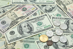 US Dollar banknotes and coins Stock Photos
