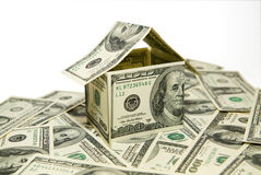 US dollar banknotes on display in the shape of a house on over w Royalty Free Stock Photos