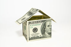 US dollar banknotes on display in the shape of a house on over w Royalty Free Stock Images