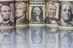 The US dollar banknotes on the glass table Stock Photos
