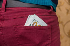 US Dollar banknotes in red jeans pocket Royalty Free Stock Images