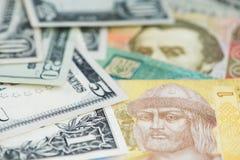 US Dollar and Ukraine Hryvnia banknotes close up image. stock photo