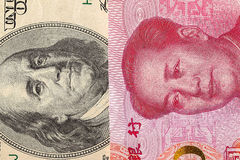 US dollar bill and China yuan banknote macro. Chinese and USA economy finance trade business, money closeup Royalty Free Stock Photos