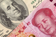 US dollar bill and China yuan banknote macro. Chinese and USA economy finance trade business, money closeup Stock Images