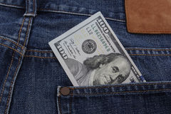 US Dollar bill (USD). In a pocket Royalty Free Stock Images