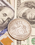 US dollar bills and coin Stock Images