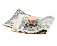 US Dollar Bills and Coins. Folded dollar bills, quarters, nickles and pennies stock images