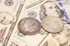 US dollar bills and coins Stock Photo