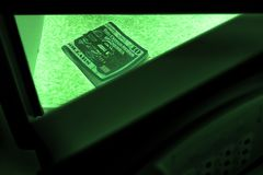 Night vision mode. US dollar bills in a safe deposit box. The concept of saving money in a hotel or bank, crime and theft. US dollar bills in a safe deposit box stock image