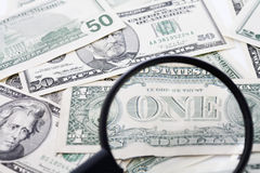 Free US Dollar Bills Seen Through Magnifying Glass, Close Up Stock Photo - 50487640