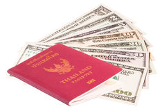Us dollar bills with Thailand passport Stock Photos