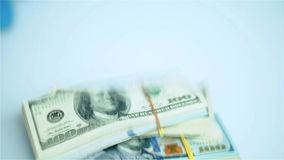 US dollar bundles falling on white surface. Wages, arnings, winnings. stock footage