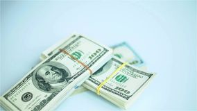 US dollar bundles falling on white surface. Wages, arnings, winnings. HD stock video footage