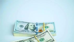 US dollar bundles falling on white surface. Wages, arnings, winnings. HD stock video