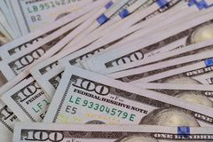 US dollar cash banknote money. One hundred US dollar bills on a table royalty free stock photo