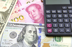 US dollar and China Yuan with calculator Stock Photo