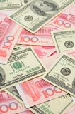 US dollar and China yuan closeup Stock Photos