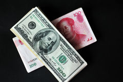 US dollar and Chinese yuan. Top view of green us dollar and red Chinese yuan , concept of exchange war Royalty Free Stock Image