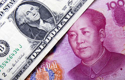 US dollar and Chinese yuan. One dollar and one hundred yuan Stock Image