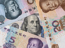 US dollar and chinese yuan background, economy finance trade con Stock Images
