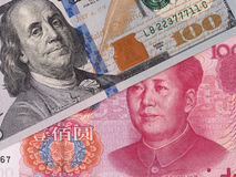 US dollar and chinese yuan banknotes, currency exchange, money c Royalty Free Stock Images