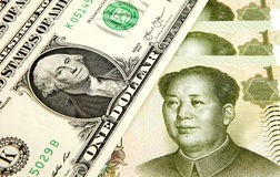 US dollar and Chinese yuan. One dollar and one yuan Stock Image