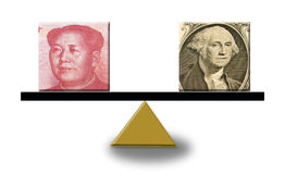 US dollar and Chinese yuan on a scale Royalty Free Stock Photos