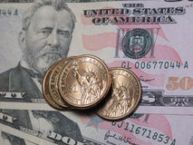 US dollar coins and $50 bills Stock Photos