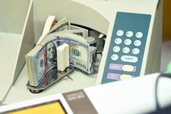 100 US dollar in counting machine Stock Photo