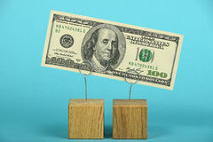 US dollar decline illustrated over blue Royalty Free Stock Photo
