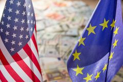 US Dollar and Euro on flags. Of the United States and European Union Royalty Free Stock Photo