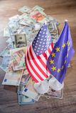 US Dollar and Euro on flags. Of the United States and European Union Stock Photos