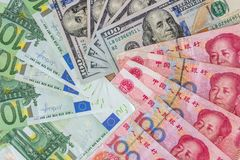 US dollar and Euro, yuan  banknotes. As background Royalty Free Stock Photography