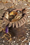 US dollar gold coins in leather pouch. Dollar gold coins with native american sacajawea's image in leather pouch and scattered around pouch Stock Image