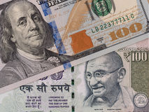 US dollar and indian rupee banknotes, currency exchange, money c Royalty Free Stock Photo