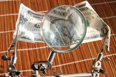 US dollar magnifying glass. US dollar bill and a magnifying glass Stock Photo