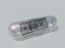 US 100 Dollar in Capsule Royalty Free Stock Photos