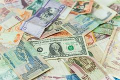 US dollar money bill in front of other international banknotes stock image