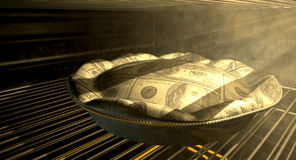 US Dollar Money Pie Baking In The Oven Royalty Free Stock Image