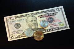 US dollar mynt och sedlar Arkivfoton