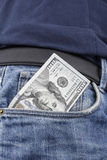 US Dollar notes in the front pocket. US Dollar note in the front pocket of a pair of  blue jeans. (100 USD note Royalty Free Stock Image