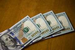 US dollar notes. Some notes of one hundred US dollars royalty free stock image