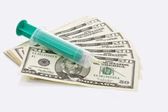 US Dollar notes, Syringe placed on top, close up Stock Photography