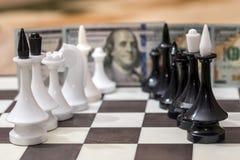 US dollar och schackdiagram Fotografering för Bildbyråer