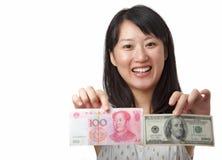 US-Dollar oder chinesischer Yuan Stockfotografie