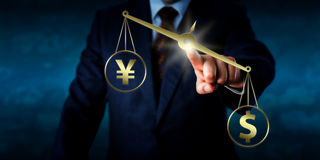 US Dollar Outweighing The Yuan On A Golden Scale royalty free stock images
